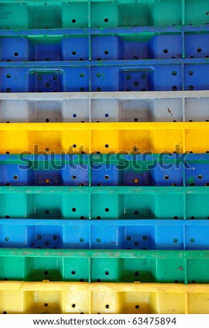 Stack of colorful plastic crates - stock photo