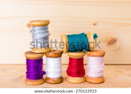 stack of colorful sewing thread - stock photo
