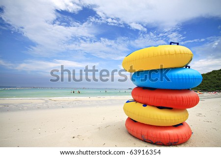 Stack of colorful swimming rings - stock photo