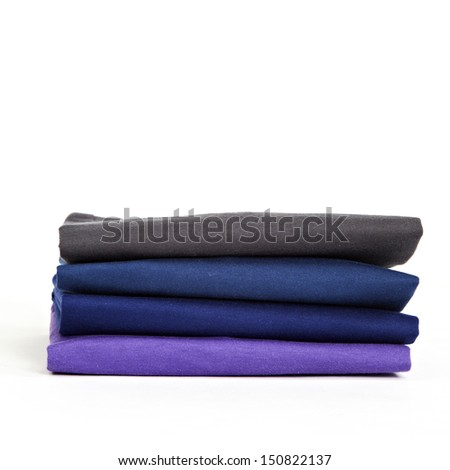 Stack of colorful t-shirts on the white background - stock photo
