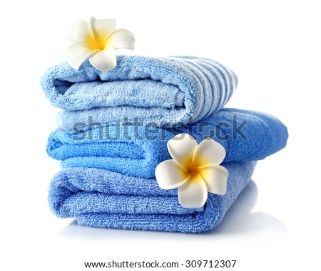 Stack of colorful towels isolated on white - stock photo