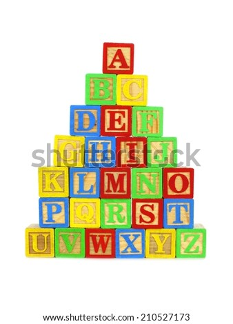 Stack of colorful toy wooden block letters over a white background - stock photo