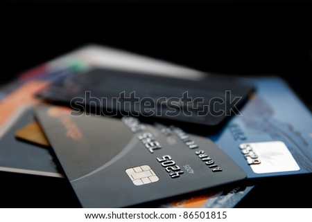 Stack of credit cards on a black background - stock photo