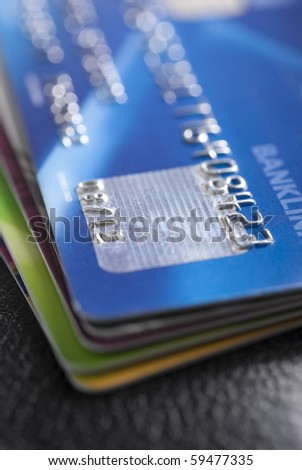 Stack of credit cards with shallow DOF - stock photo
