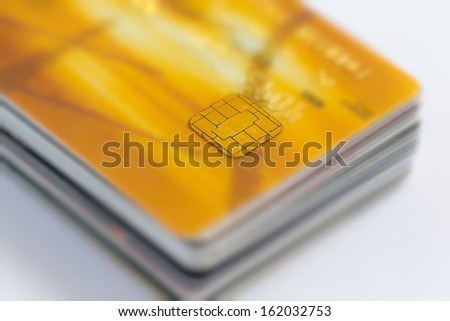 Stack of credit cards with shallow DOF, gold card on top. - stock photo