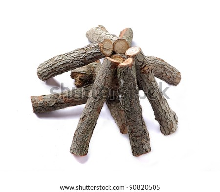 stack of cut logs fire wood isolated over white background - stock photo