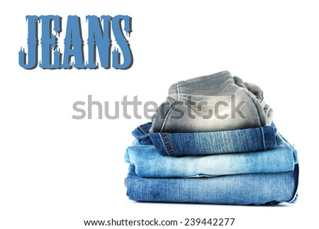 stack of denim clothes on white background - stock photo