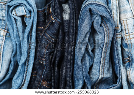Stack of different blue jeans  - stock photo