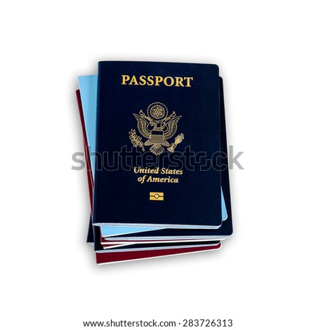 Stack of different color passports with dark blue US passports on the top - stock photo