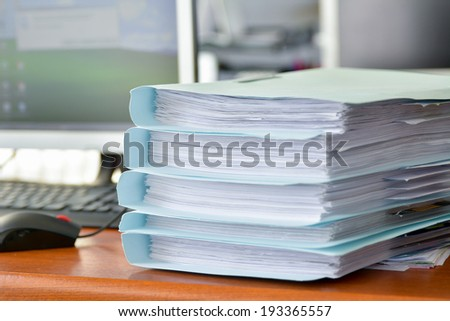 Stack of document folders on the table - stock photo