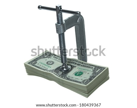 Stack of dollar bills with a c-clamp on them - stock photo