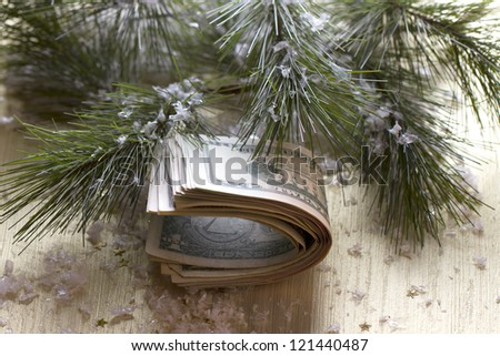 stack of dollars on the Christmas tree - stock photo