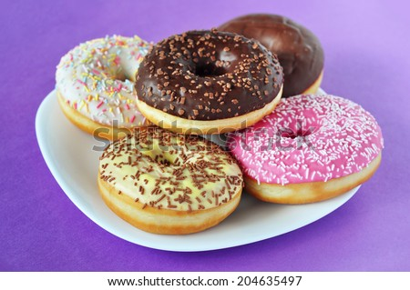 Stack of doughnuts on a plate - stock photo