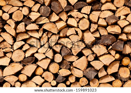 Stack of dried firewood of birch wood - stock photo