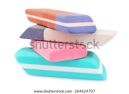 Stack of erasers isolated on white - stock photo