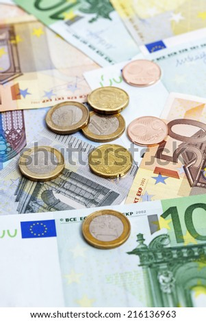 Stack of euro notes and coins - stock photo