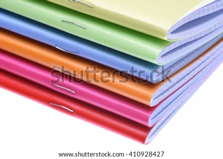 Stack of exercise books isolted on white background - stock photo