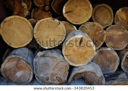 stack of firewood in rustic barn, horizontal - stock photo