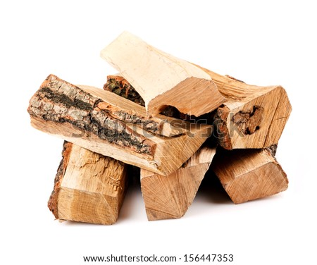 stack of firewood isolated on white background - stock photo
