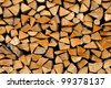 Stack of firewood - wooden abstract background - stock photo