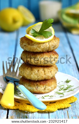 Stack of fish cutlet on a white plate. - stock photo