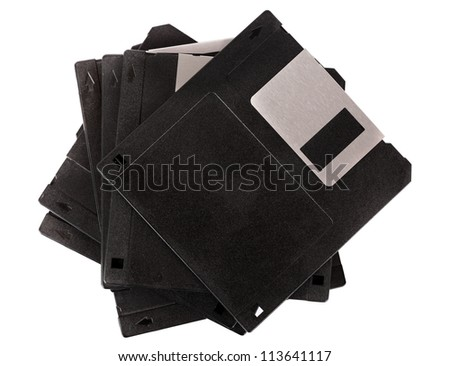 Stack of floppy disks isolated on white - stock photo