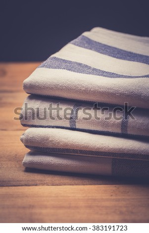 Stack of folded kitchen towels - stock photo