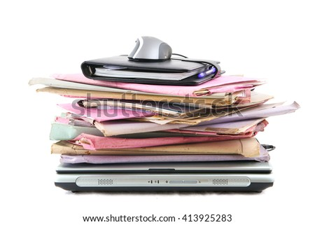 Stack of folder with laptop computer and a mouse, isolated on white background - stock photo
