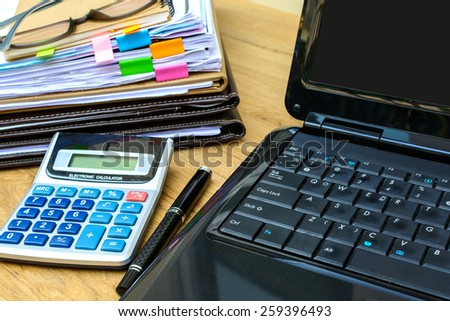 stack of folders and documents on office desk - stock photo