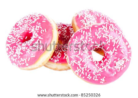 Stack of four donuts isolated on white - stock photo