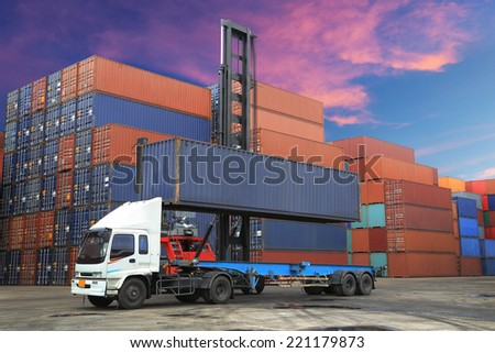 Stack of Freight Containers at the Docks with Truck at twilight time - stock photo
