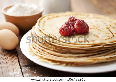 stack of freshly made crepes - stock photo