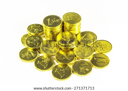 Stack of golden coins on white background - stock photo