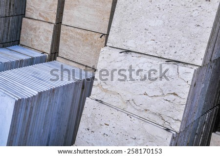 stack of granite slab - marble industry factory smooth surface sandstone - stock photo