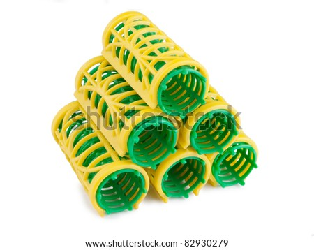 stack of hair rollers isolated on a white background - stock photo