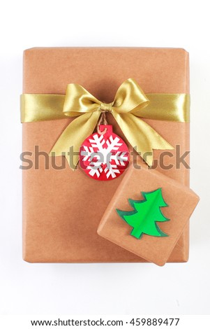 Stack of handcraft christmas gift boxes isolated on white background - stock photo