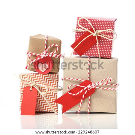 Stack of handcraft gift boxes on white background  - stock photo