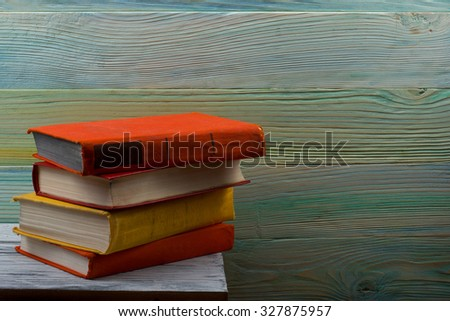 Stack of hardback books on wooden table. Back to school. Copy space - stock photo