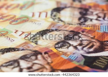 Stack of Israeli money bills of 100 shekel. - stock photo