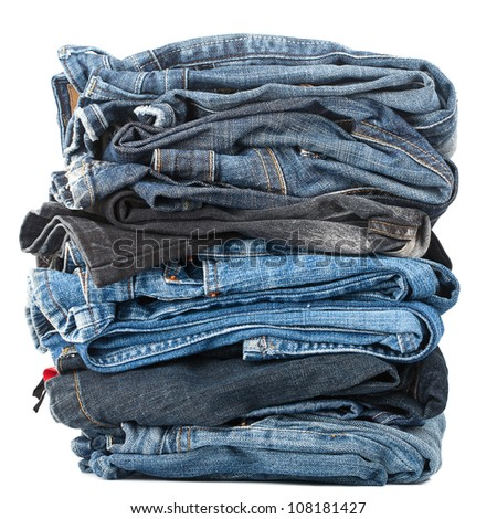 Stack of jeans isolated on white background - stock photo