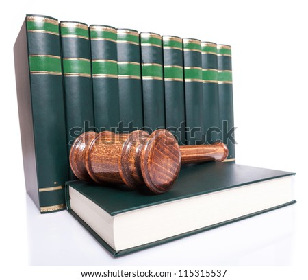 stack of law books and a judge gavel on a book on white backgroun - stock photo