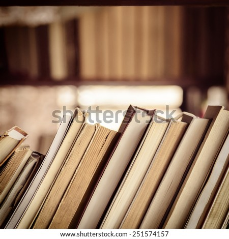 Stack of library books. Old fashioned look. Square composition - stock photo