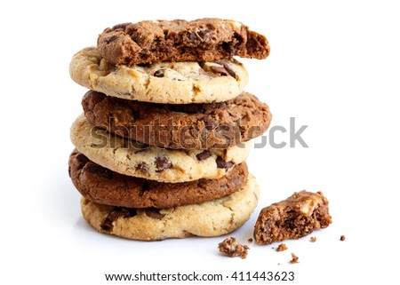 Stack of light and dark chocolate chip cookies isolated. One half with crumbs. - stock photo