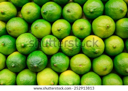 Stack of limes on display at market - stock photo