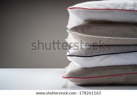 Stack of linen pillows - stock photo