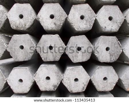 Stack of many Hexagon concrete pillar - stock photo