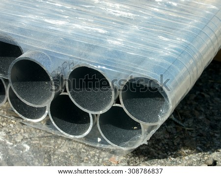 Stack of Many Pipes at the Construction Site - stock photo