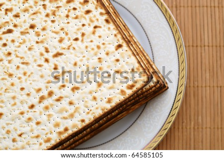 Stack of matzot (matzah - unleavened bread). Symbol of jewish passover. - stock photo
