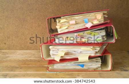 stack of messy file folders and documents,free copy space - stock photo