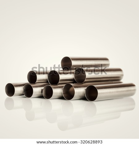 Stack of metal pipes. Chrome steel tubes - stock photo